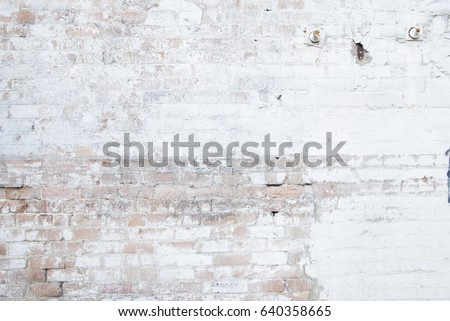 old weathered exposed brick wall background texture