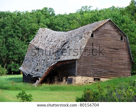 old weathered farm buildings - stock photo