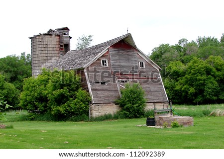 old weathered farm buildings leaning