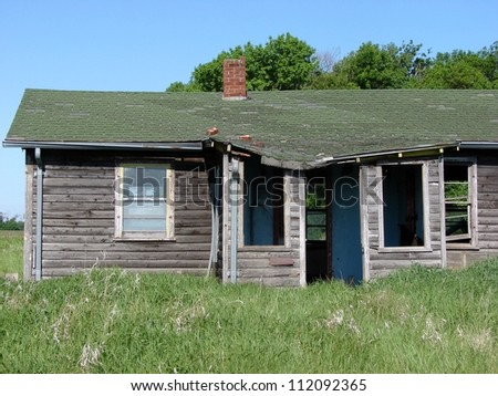 old weathered farm buildings log house - stock photo