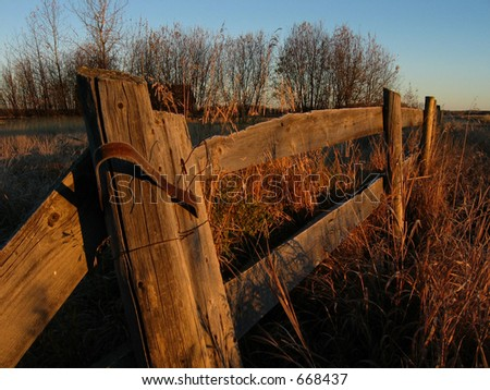 Old weathered fence with a touch of frost - stock photo