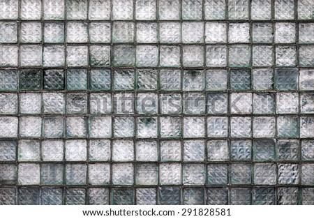 Old weathered glass block wall background - stock photo