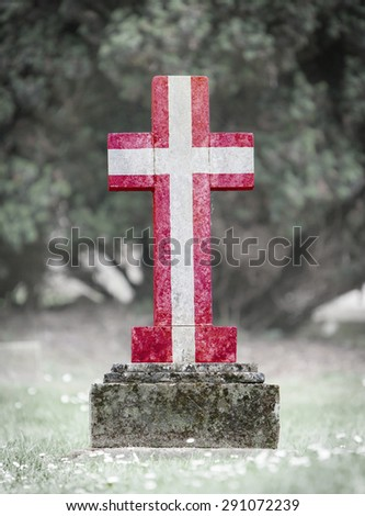 Old weathered gravestone in the cemetery - Denmark - stock photo