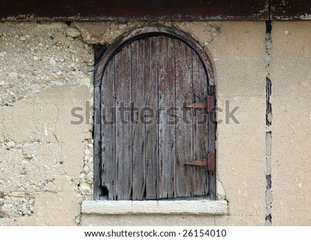 Old weathered hayloft door with rusted hinges