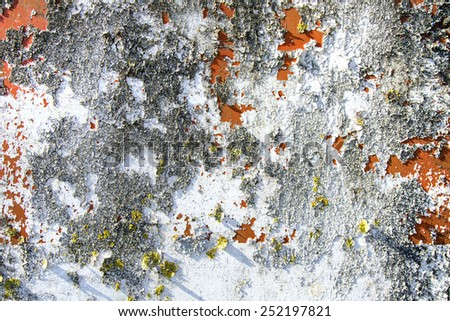 Old weathered painting on metal. - stock photo