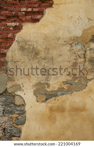 Old weathered plaster on the brick Wall. The photo was taken on the Kola Peninsula in the abandoned village. - stock photo
