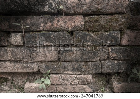 Old weathered Red brick wall fragment Background in Shadow - stock photo