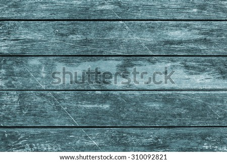Old Weathered, Rotten, Cracked Planking, Bleached and Stained Cyan, Vignette Grunge Texture Detail. - stock photo