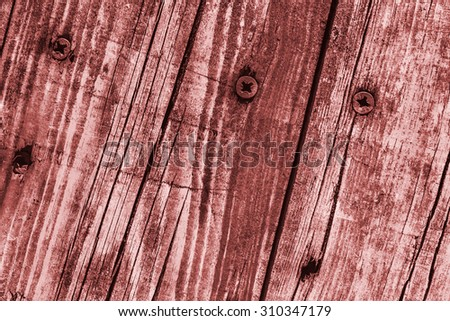 Old Weathered, Rotten, Cracked Planking, Bleached and Stained Red, Grunge Texture Detail. - stock photo