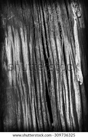 Old Weathered, Rotten, Cracked, Square Timber Bollard, Bleached and Stained Gray, Vignette Grunge Surface Texture Detail. - stock photo