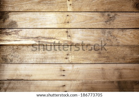 Old weathered rustic wooden background texture with vintage brown wood boards with an uneven row of nails in the centre and stained woodgrain pattern, empty with copyspace - stock photo