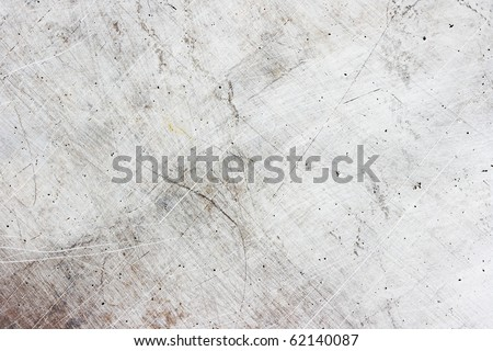 Old weathered scratchy metal plate texture - stock photo
