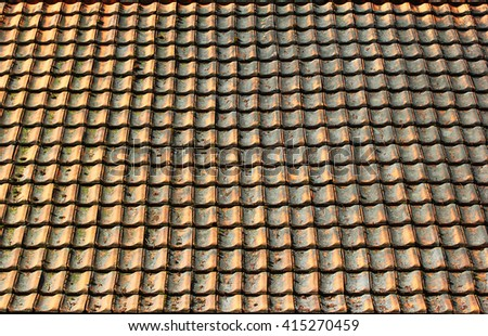 Old weathered shingle roof pattern background. Dirty and dingy stained ceramic tiles texture. - stock photo
