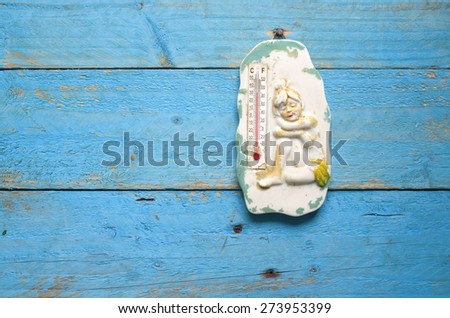 old weathered thermometer, summer heat, free copy space - stock photo