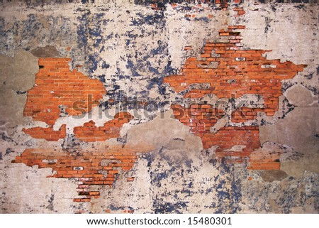 Old weathered urban wall with bricks and cracked paint - stock photo