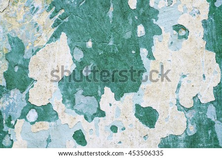 Old weathered wall in green - stock photo
