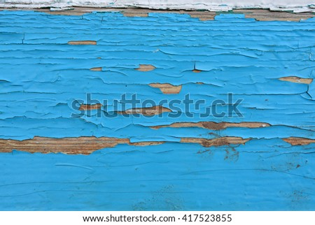old, weathered, wooden fence plank with grungy, blue paint texture peeling off, close up, background, horizontal - stock photo