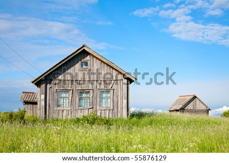 Old weathered wooden house in Karelia, Russia - stock photo