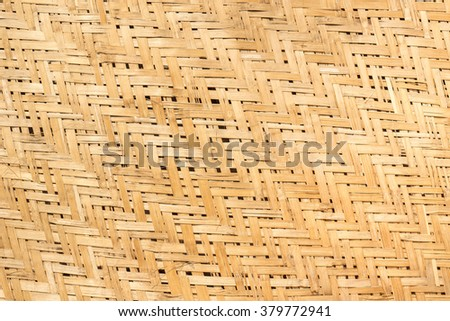 Old weathered yellow-brown zigzag interlocking of coconut leaves weave - stock photo