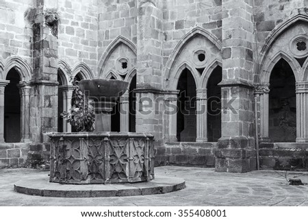 Old well located in the cloister of the Cathedral in Plasencia. Spain.