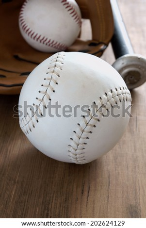 Old well used baseballs with mitt and bat - stock photo