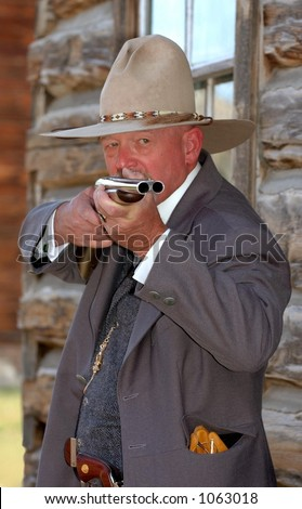Old West Sheriff Aiming Rifle