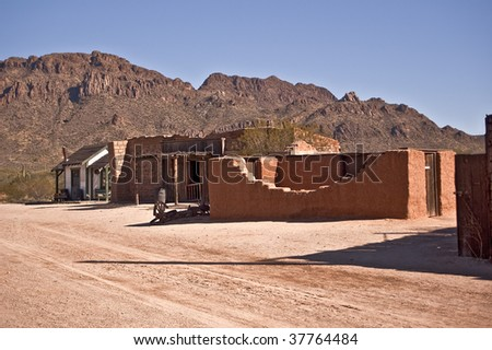 Old Western Street with adobe ruins outside Tucson, Arizona. - stock photo