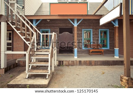 Old western style building and bar - stock photo