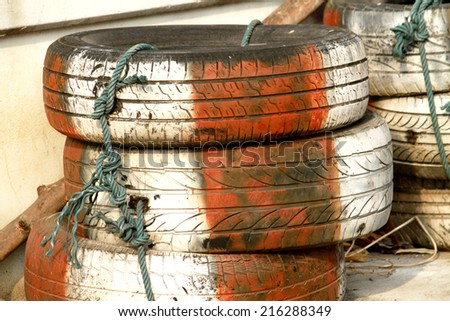 Old wheel car barrier - stock photo