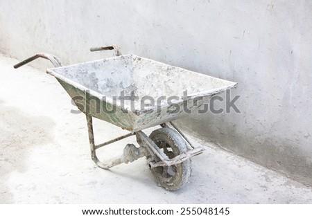 Old wheelbarrow - stock photo
