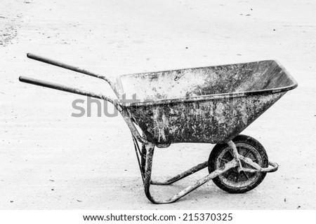 Old Wheelbarrow isolated on white background. - stock photo
