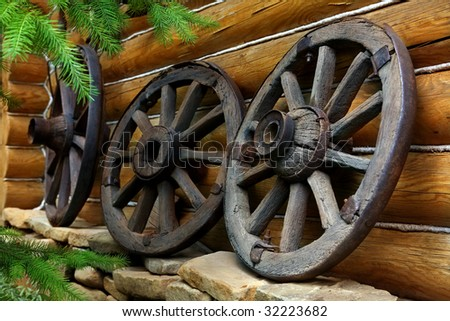 Old wheels from a cart - stock photo