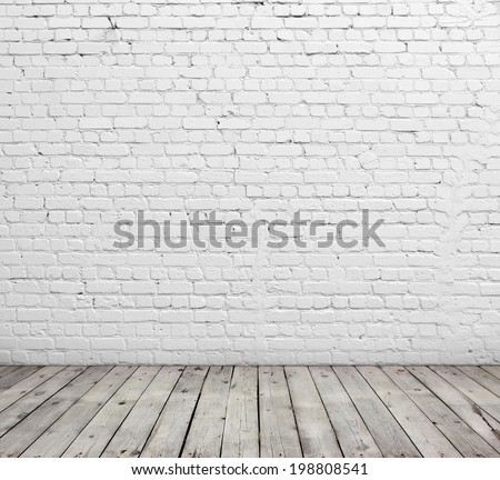 Old white brick wall and wood floor. - stock photo