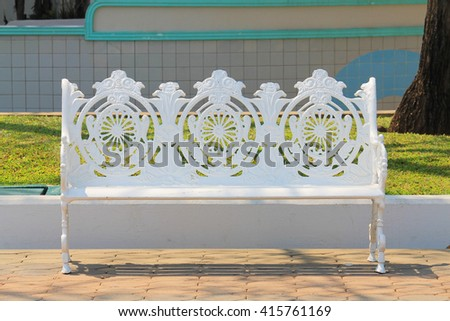 Old white chairs outdoors - stock photo