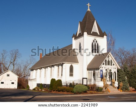 Old white church on a clear November day - stock photo