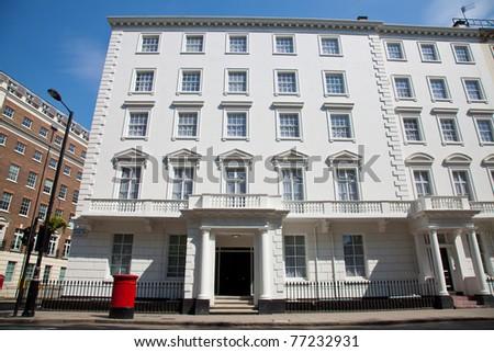 Old white georgian houses in London - stock photo