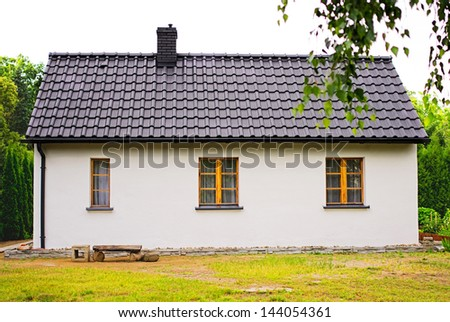 old white house with wooden windows - stock photo