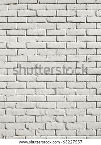 Old white painted brick wall close up background. - stock photo
