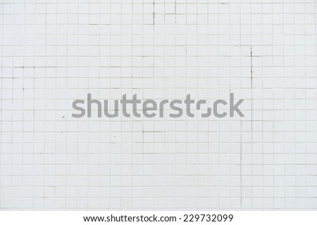Old white tile wall background. - stock photo