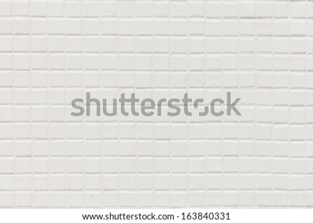 old white tiled wall - stock photo