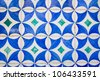 Old white tiles with blue painting - stock photo