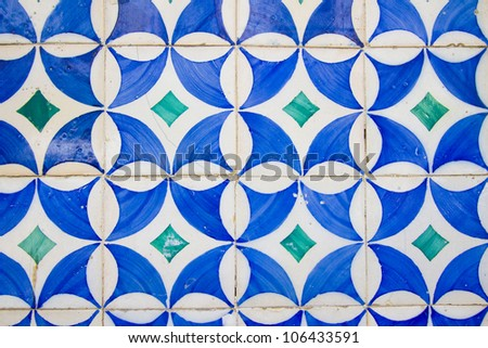 Old white tiles with blue painting