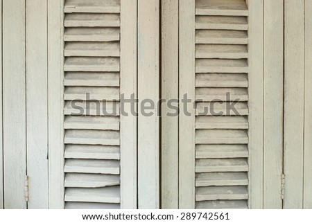Old white wooden window shutters. - stock photo