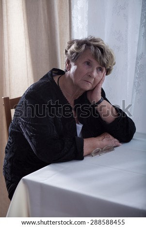 Old widow has lots of problems after her husband's death - stock photo