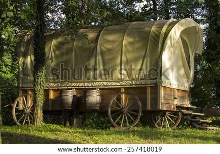 Old wild west covered wagon. - stock photo