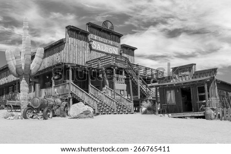 Old Wild West desert cowboy town with cactus and saloon in Black and White - stock photo