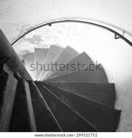 Old winding staircase in a historic tower - stock photo