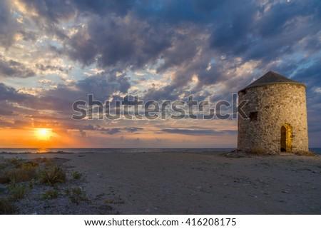 Old windmill ai Gyra beach, Lefkada Greece - stock photo