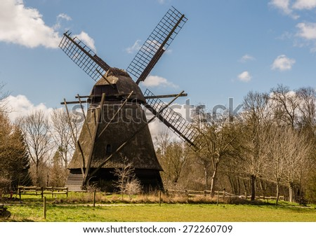 Old windmill among trees