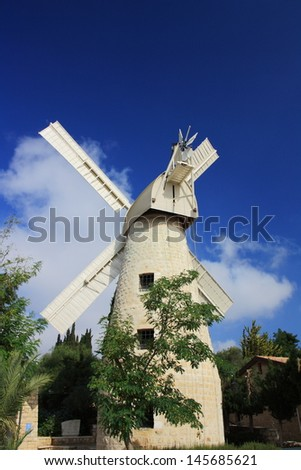 Old Windmill at Mishkenot Shaananim , the first Jewish neighborhood outside the Old City in Jerusalem - stock photo